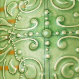 Pillow tile detail Green scroll w. tangerine