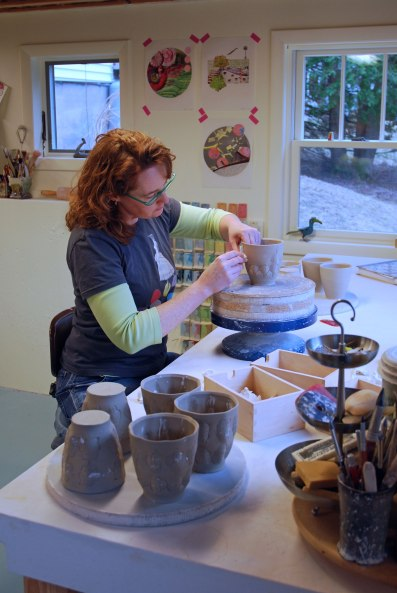 Kristen Kieffer stamping in her Massachusetts studio