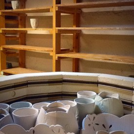 Kristen Kieffer loaded kiln and empty ware shelves