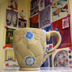 Kristen Kieffer stamped mug with blue flowers in progress