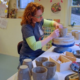 Kristen Kieffer stamping mugs in home studio